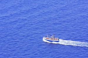 bigstock-Fishing-boat-on-the-sea-31775852